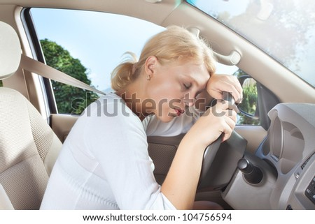 portrait of young beautiful woman sitting in the car #104756594
