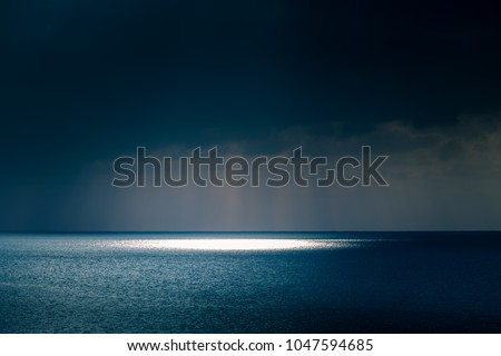 A beautiful landscape of a sea in winter evening. Baltic sea at the sunset. Vivid colors. #1047594685