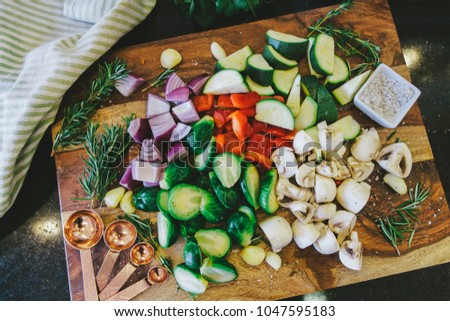 Chopped vegetable medley on wooden cutting board #1047595183