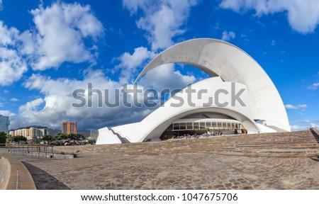 Santa Cruz de Tenerife, Canary Islands, Spain - February 8, 2018: Auditorio, iconic landmark - opera house of Santa Cruz de Tenerife, built in 2003 in organic shapes, designed by Santiago Calatrava #1047675706
