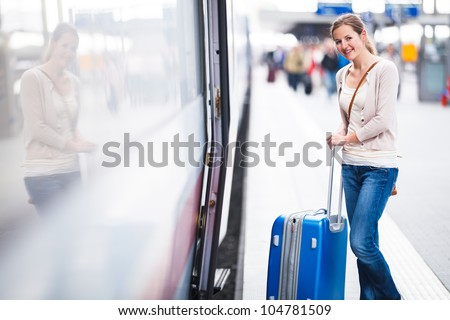 Pretty young woman boarding a train (color toned image) #104781509
