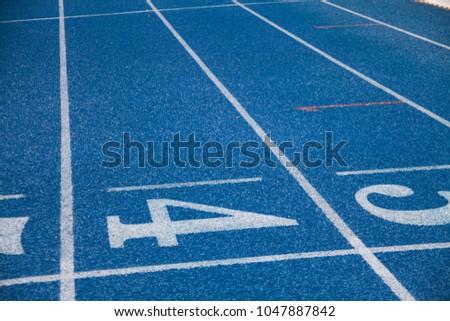 blue track in the stadium #1047887842