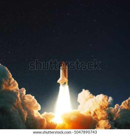 The space shuttle rockets launch into space on the starry sky. spacecraft flies into space with clouds of smoke. Concept  #1047890743