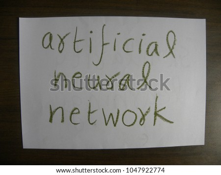 Text artificial neural network hand written by green oil pastel on white color paper #1047922774