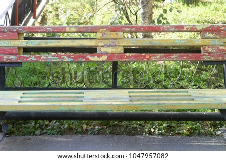 A bench on a city street. Summer and autumn background  #1047957082