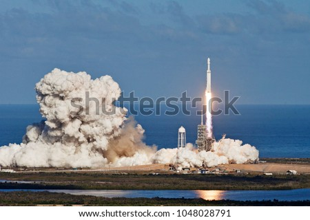 Rocket launch. Elements of this image furnished by NASA #1048028791