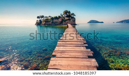 Bright spring view of the Cameo Island. Picturesque morning scene on the Port Sostis, Zakinthos island, Greece, Europe. Beauty of nature concept background. Royalty-Free Stock Photo #1048185397