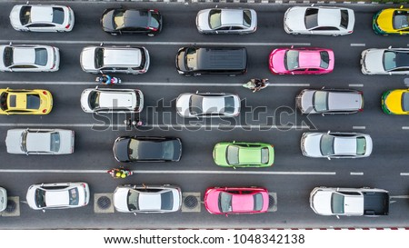 Aerial drone photograph of traffic jam in metropolis city. Royalty-Free Stock Photo #1048342138