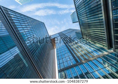 glass architecture of modern building in tokyo #1048387279