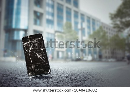 Mobile phone falls on the street