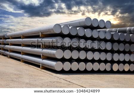Heap of aluminium bar in aluminum profiles factory #1048424899