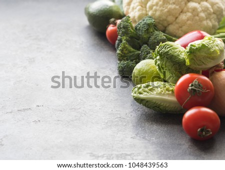Various vegetables and fruits on a gray background. Food background. Healthy vegetarian and diet food concept. Open space.   #1048439563