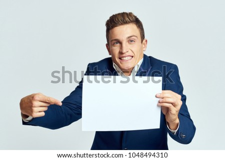 business man smiling showing his finger in place for copy                              #1048494310