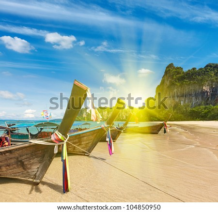 Long tail boats on tropical beach in Thailand oin sunset #104850950