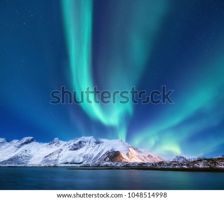 Northen light under mountains. Beautiful natural landscape in the Norway #1048514998