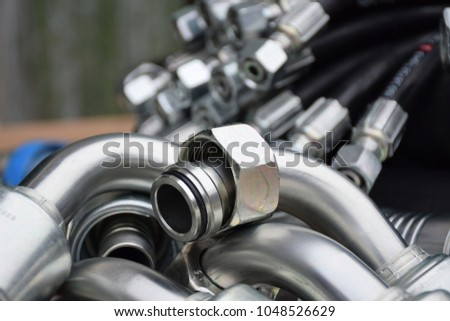 Fittings and hydraulic hoses Royalty-Free Stock Photo #1048526629