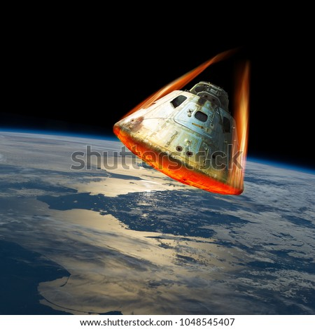 A space capsule reenters the earths atmosphere causing the heat shield to glow from the friction of tremendous speed. Elements of this image courtesy of NASA. #1048545407