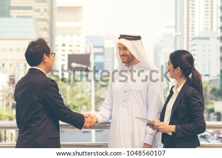 Arab businessman make a handshake with his partnership. First meeting with partner, secretary support to translate language during business talk. Happiness and smiling conference with successful deal