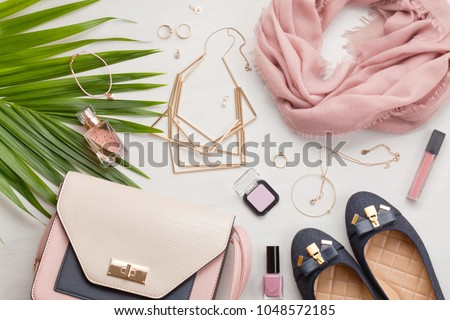Flat lay with women accessories. Fashion, trends and shopping concept Royalty-Free Stock Photo #1048572185