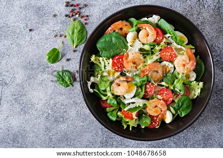 Healthy salad plate. Fresh seafood recipe. Grilled shrimps and fresh vegetable salad and egg. Grilled prawns. Healthy food. Flat lay. Top view #1048678658