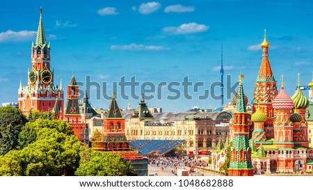 Panoramic view of the Red Square with Moscow Kremlin and St Basil's Cathedral in summer, Moscow, Russia. It is a main tourist destination in Moscow. Beautiful scenery of the heart of sunny Moscow. #1048682888
