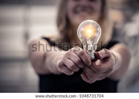 woman hand hold light bulb creativity ideas concept #1048731704