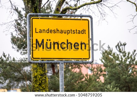 General city entry sign of Munich, the capital of Bavaria in Germany - Europe - Translation: state capital Munich.