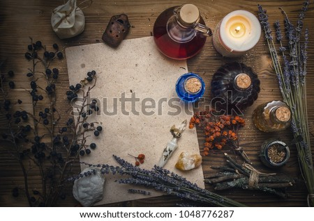 Magic potion ancient recipe scroll with copy space. Alternative herbal medicine. Shaman table with copy space. Druidism concept. Witch doctor desk background. #1048776287