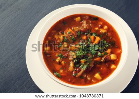 Tomato soup with red beans, potato and carrot. Vegan diet. European cuisine. Vegetarian dish. Main course. Organic meal. #1048780871