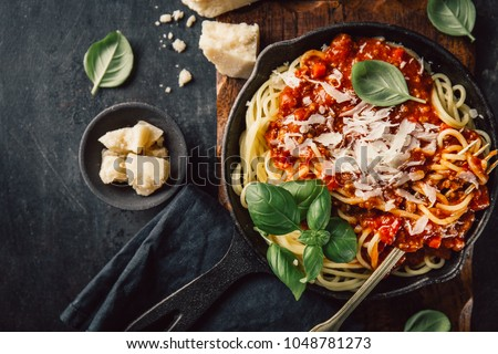 Top view of frying pan filled with pasta with cheese and tomato sauce.  #1048781273