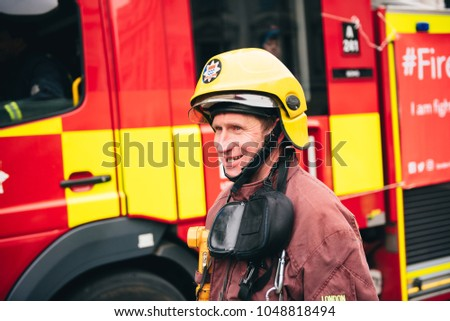 London / UK - 03/17/2017: Fireman at St Patrick's Day Parade #1048818494