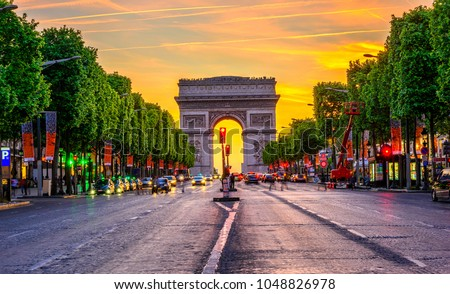Champs-Elysees and Arc de Triomphe at night in Paris, France. Architecture and landmarks of Paris. Postcard of Paris #1048826978