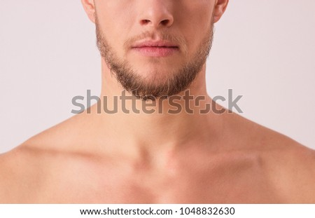 Close up of attractive young man's half face isolated over white background. Portrait of bearded hipster's upper body and mouth. Masculinity and charisma of handsome man. Male's beauty concept #1048832630