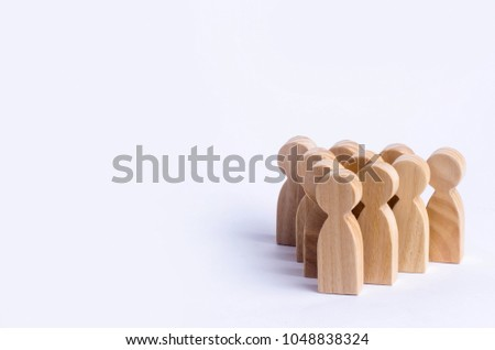 People stand in the formation of the pins. A game of bouwling. Wooden figures of persons, on a white background. The concept of business management personnel and the achievement of goals. #1048838324