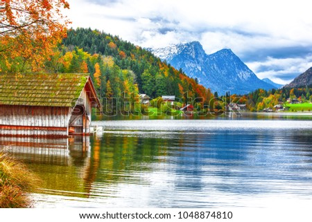 Two white swans in crystal clear water Grundlsee Lake. Beautiful landscape of alps. Location: resort Grundlsee, Liezen District of Styria, Austria, Alps. Europe. #1048874810
