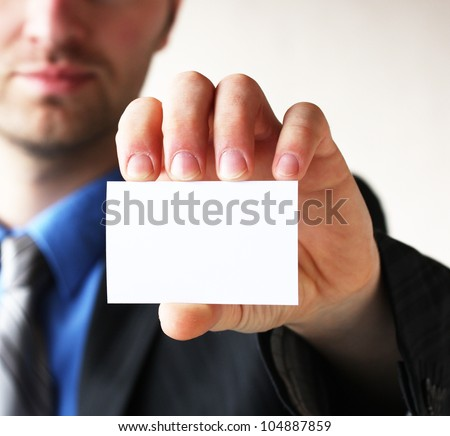 Businessman holding his business card in hand #104887859
