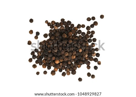 Close-up image of black pepper on white background, view above #1048929827