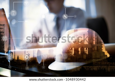 Double exposure of Engineer with oil refinery industry plant background, industrial instruments in the factory and physical system icons concept #1048930442