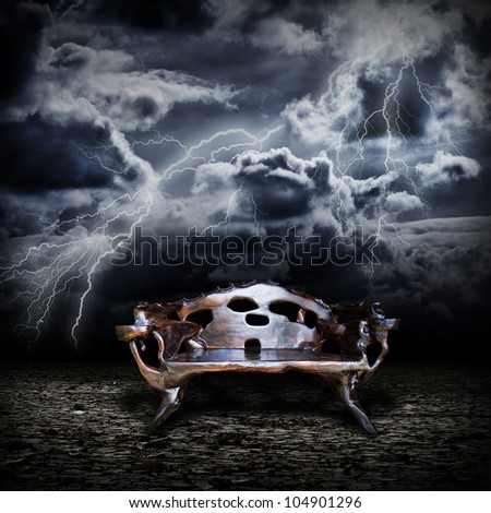 Majestic wooden throne standing on the abandoned land during a storm #104901296