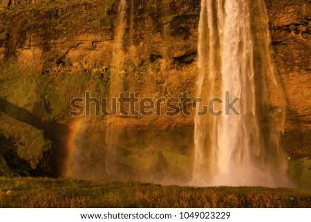 Seljalandsfoss waterfall during the sunset, Iceland #1049023229