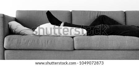Man sleeping on the sofa #1049072873
