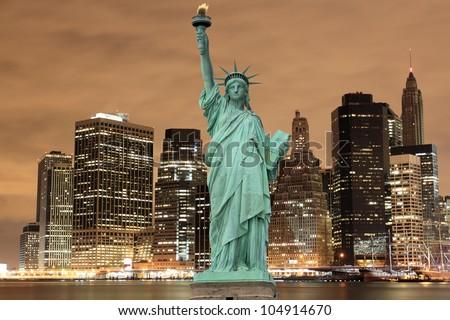Manhattan Skyline and The Statue of Liberty at Night, New York City #104914670