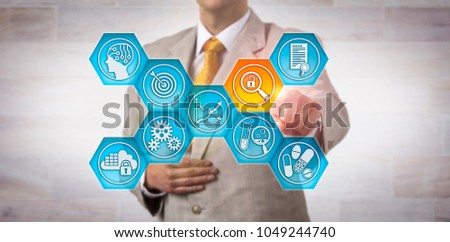 Unrecognizable investigator finding a data integrity risk in a pharma lab app. Pharmaceutical industry concept for increased regulatory scrutiny, vulnerability in drug quality safeguarding process. #1049244740
