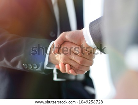 Business men giving a handshake. Business concept #1049256728