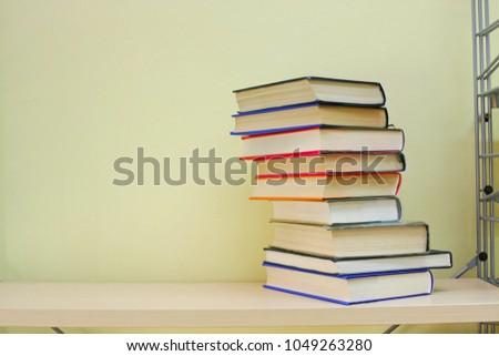 Stack of books on shelf #1049263280