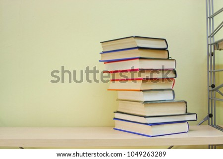 Stack of books on shelf #1049263289