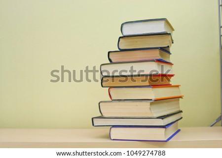 Stack of books on shelf #1049274788