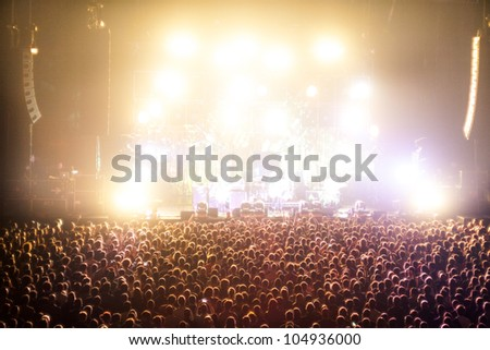 Cheering Crowds in a rock concert #104936000