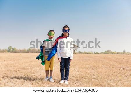 Superhero Kid Playing Fun Cheerful Concept. #1049364305