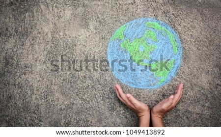 Closeup hands holding earth draw with chalk. World harmony green peace environment earth day together concept banner. #1049413892